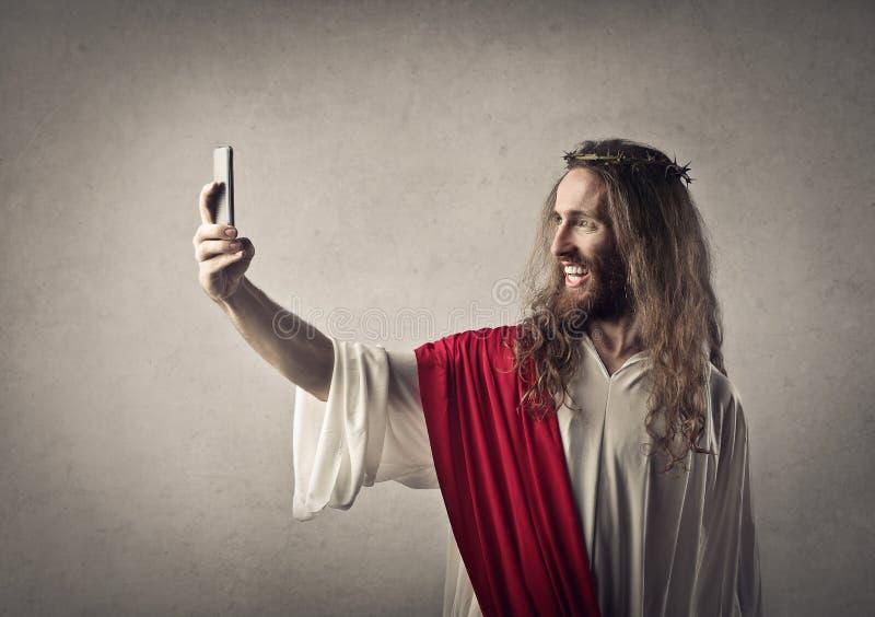 Jesus, der ein selfie nimmt stockbilder