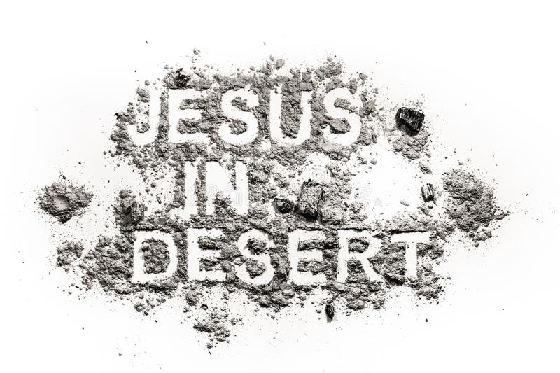 Jesus in desert written in ash. Dust or sand as lent, ash wednesday, easter, fast and abstinence time in bible concept and christian religion background royalty free stock photos