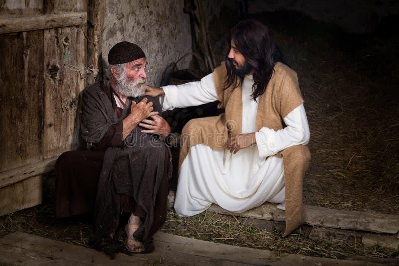 Jesus die de lamé oude man helen stock fotografie