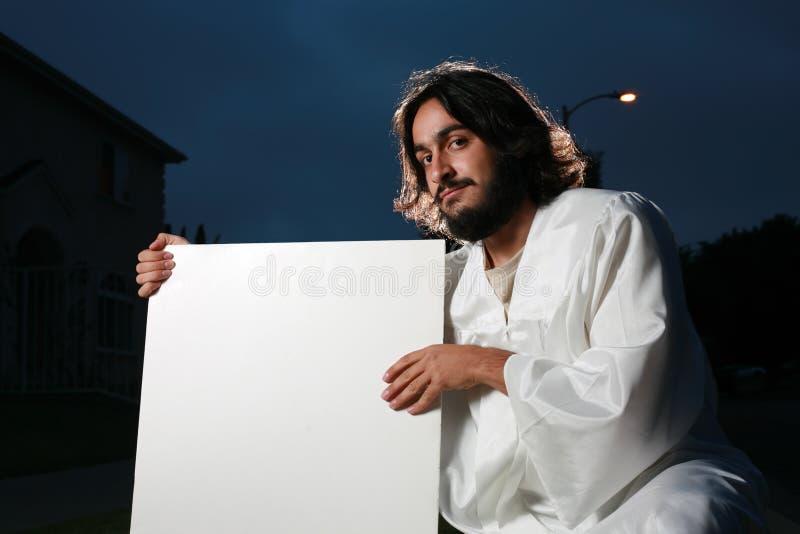 Jesus die een leeg teken houdt royalty-vrije stock afbeeldingen