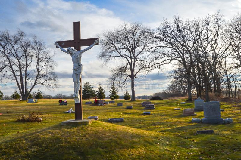 Jesus Dying on Cross, Crucifix, Cemetary, Good Friday. Jesus dying on a cross on a hill in a cemetery.  Easter, Good Friday, Religion, Christ Jesus, Easter stock photos