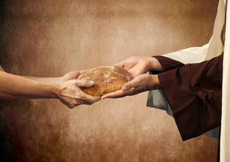 Jesus geeft het brood aan een bedelaar. stock afbeelding