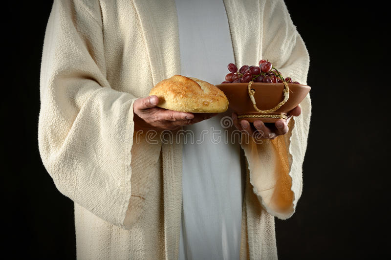 Jesus Hands Holding Bread and Grapes royalty free stock photography