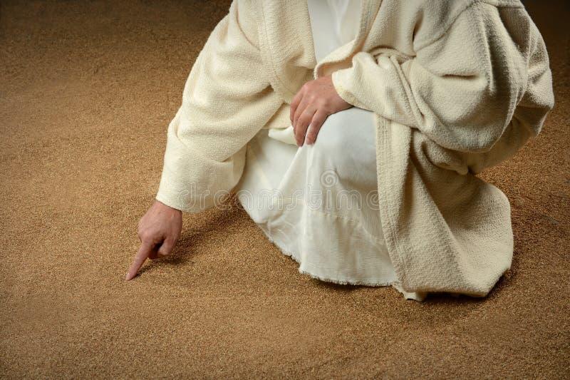 Jesus handstil i sanden arkivfoton