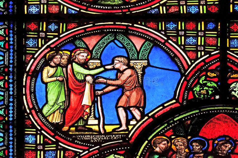 Jesus heals a blind man. Stained glass window from Saint Germain-l `Auxerrois church in Paris, France stock images