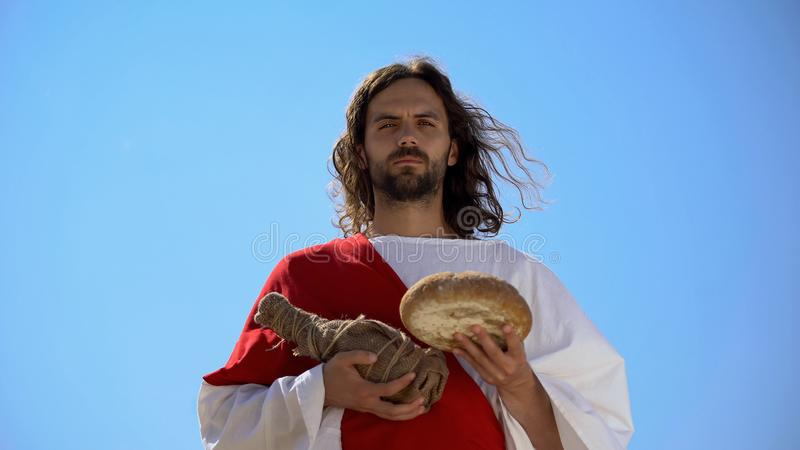 Jesus holding bread and bottle of wine, sharing sacramental meal, Holy Eucharist. Stock photo royalty free stock photos