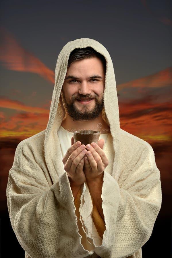 Jesus Holding Communion Cup royalty-vrije stock afbeelding