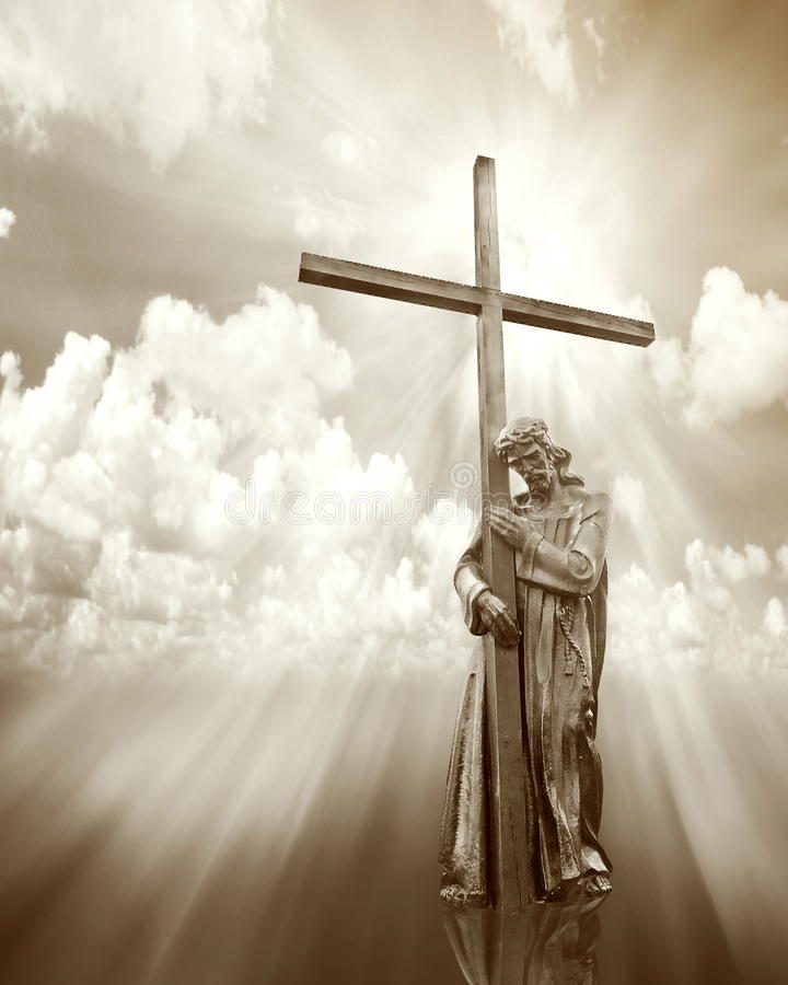 Jesus holding a cross. On cloud sepia background stock photography