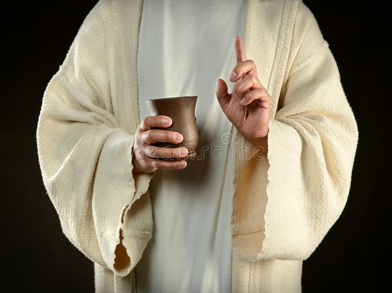 Download Jesus Holding Cup of Wine stock photo. Image of religion - 27448912