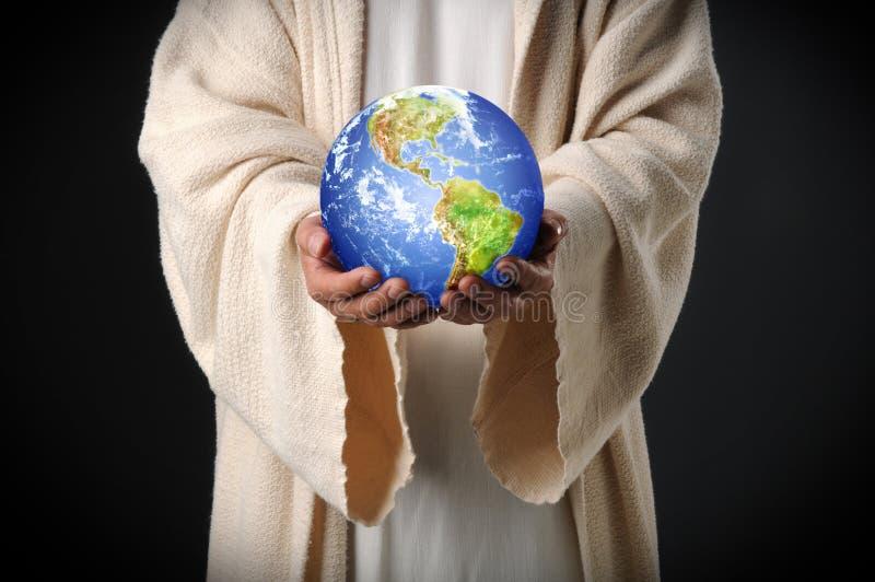 Jesus-Holding-Welt in seinen Händen stockbild