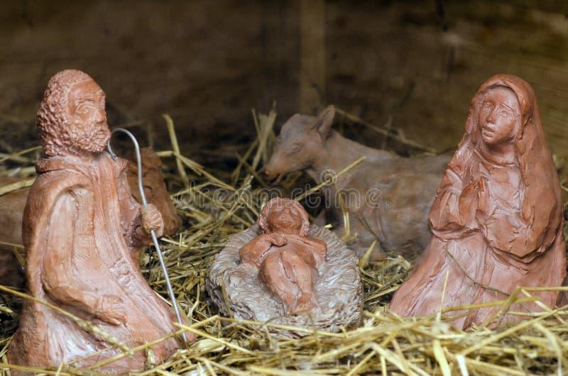 jesus josef mary för christ jullathund julkrubba royaltyfria foton