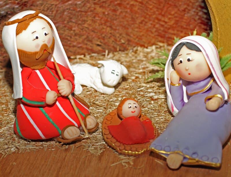 Jesus, Joseph och Mary i en krubba arkivbild