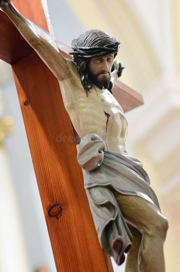 Jesus kruisigde Christus op een houten kruis royalty-vrije stock foto