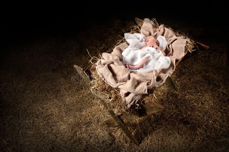 Jesus Laying auf einer Krippe stockfotos