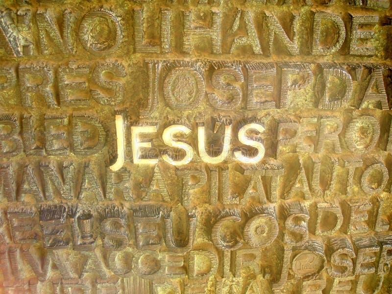 jesus letters skrivet metalliskt royaltyfri foto