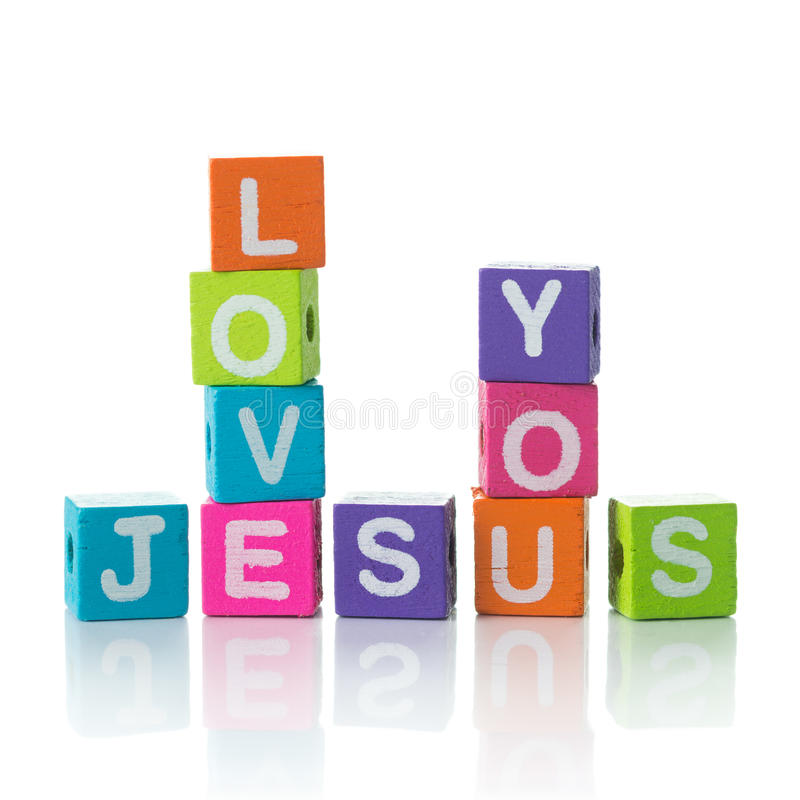 Jesus love you. 'Jesus love you' sign illustrated with colorful cubes and arranged in crossword style royalty free stock image
