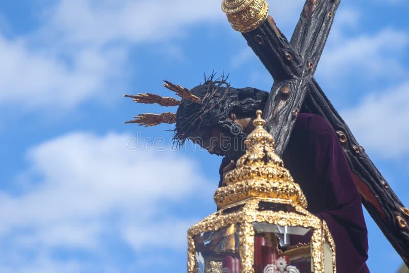 Jesus met de dwars, Heilige Week in Sevilla, broederschap van San Roque stock fotografie