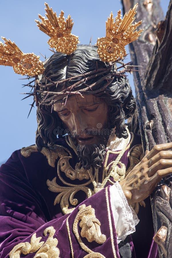 Jesus met de dwars, Heilige Week in Sevilla, broederschap van San Roque stock afbeeldingen