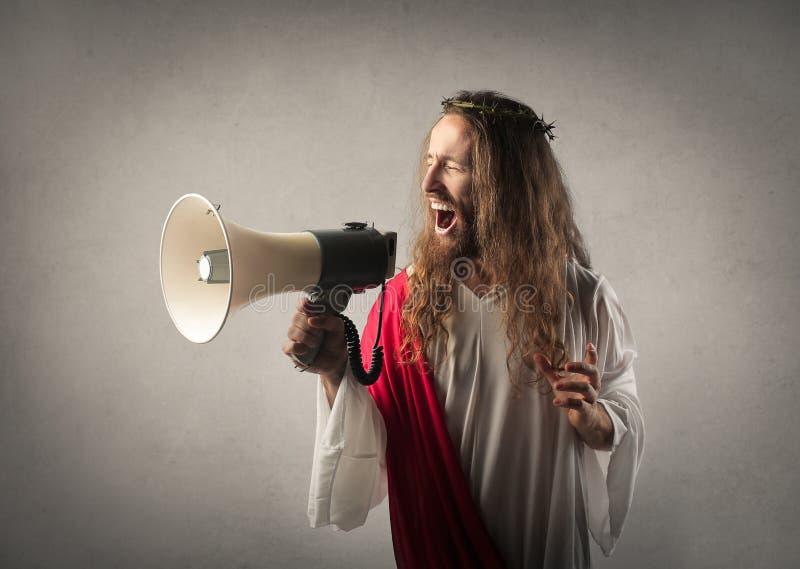 Jesus met een megafoon royalty-vrije stock fotografie