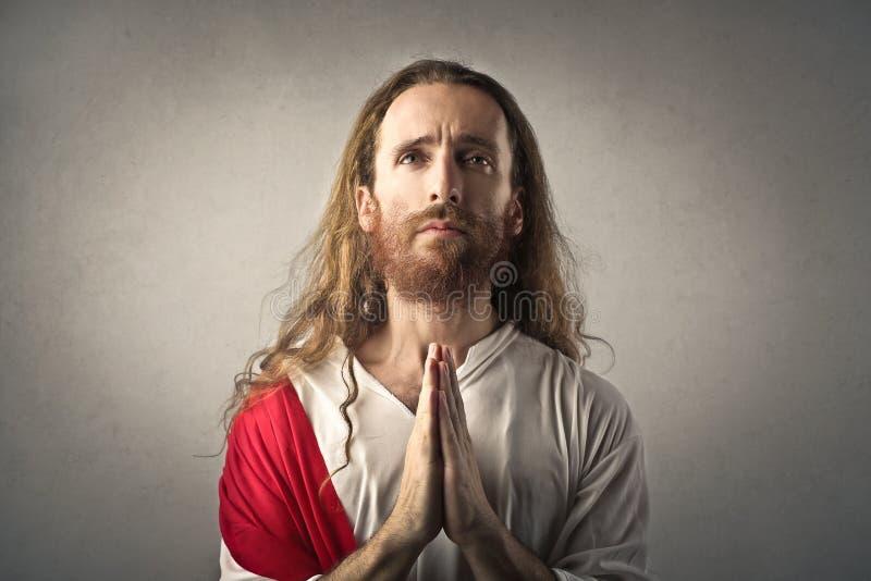Jesus met handen het bidden stock fotografie