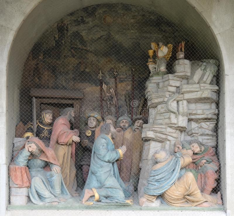 Jesus on the Mount of Olives, surrounded by approaching soldiers and the Apostles, portal of the church of St. Leodegar in Lucerne stock photos