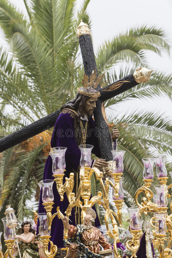 Jesus of Nazareth carrying wooden cross, Throne more popular in. This city, represents jesus bearing the cross to Mount Calvary to be crucified, Linares stock image