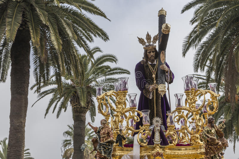 Jesus of Nazareth carrying wooden cross, Throne more popular in. This city, represents jesus bearing the cross to Mount Calvary to be crucified, Linares royalty free stock photography