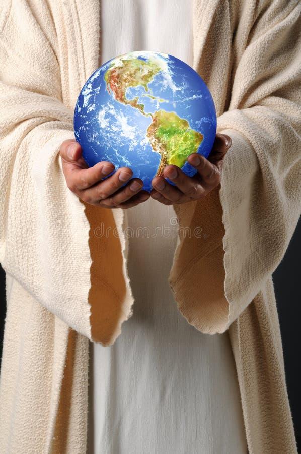 Jesus passa la terra della holding immagini stock