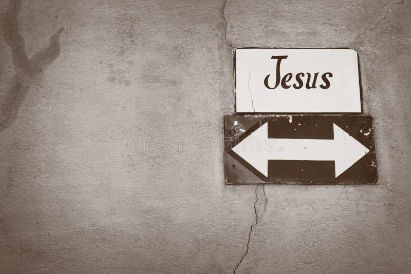 Jesus-pilsignering på en sprucken vägg arkivfoton