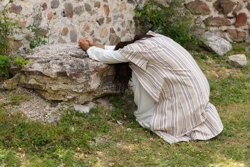 Jesus praying in despair at Ghetsemane royalty free stock photo