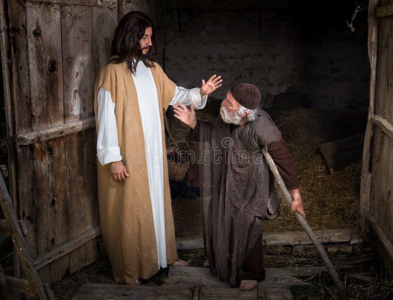 Jesus que cura o aleijado fotos de stock royalty free