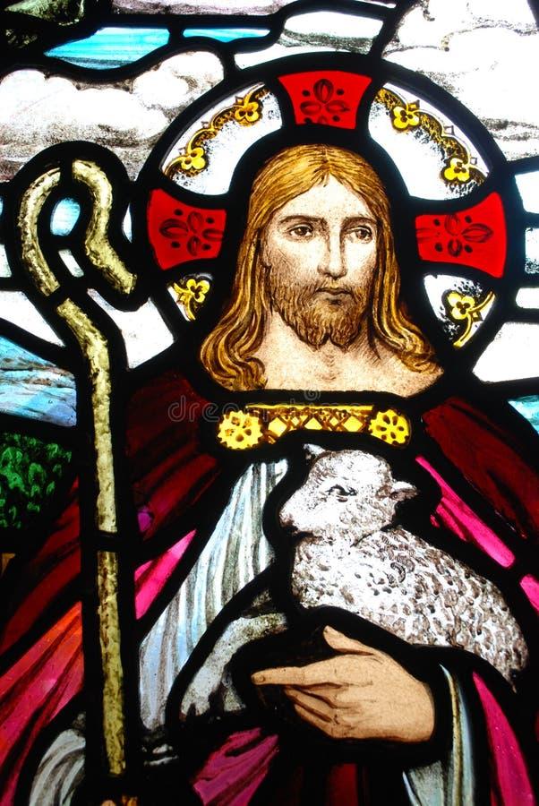 Jesus que guarda um cordeiro foto de stock royalty free