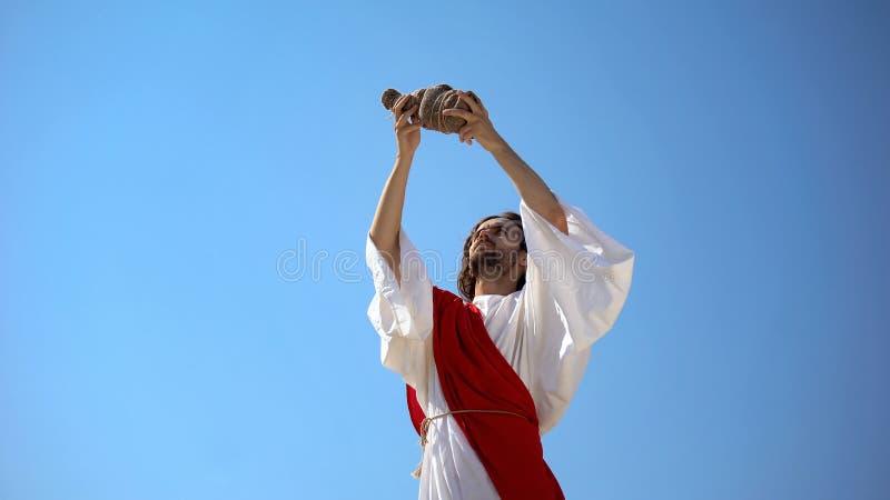 Jesus raising wine in hands to sky, blessing sacramental Eucharist beverage. Stock photo stock photography