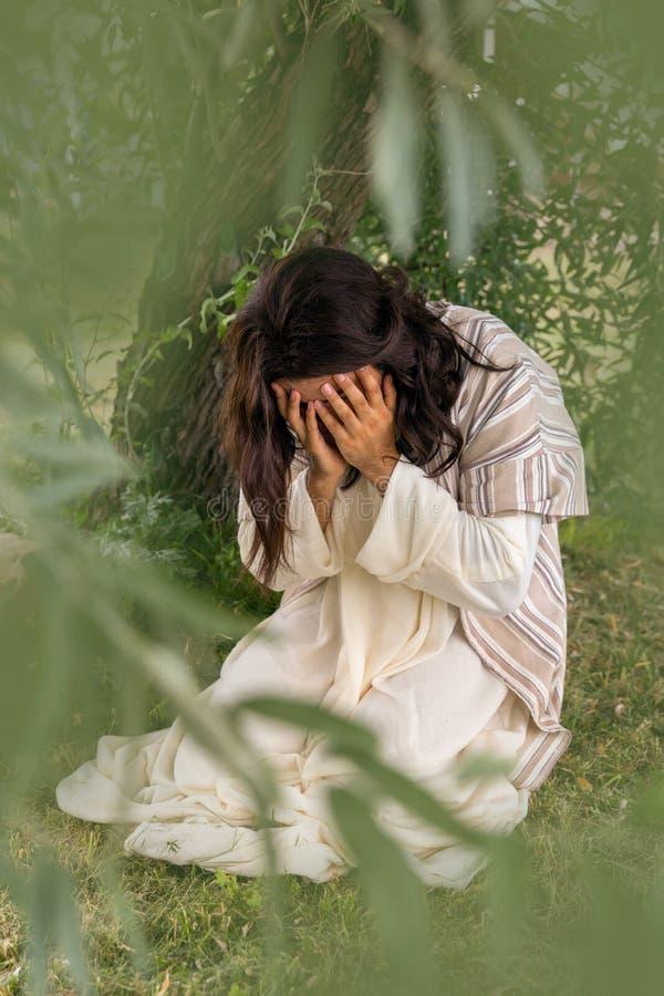 Jesus som ber i dödskamp arkivbilder