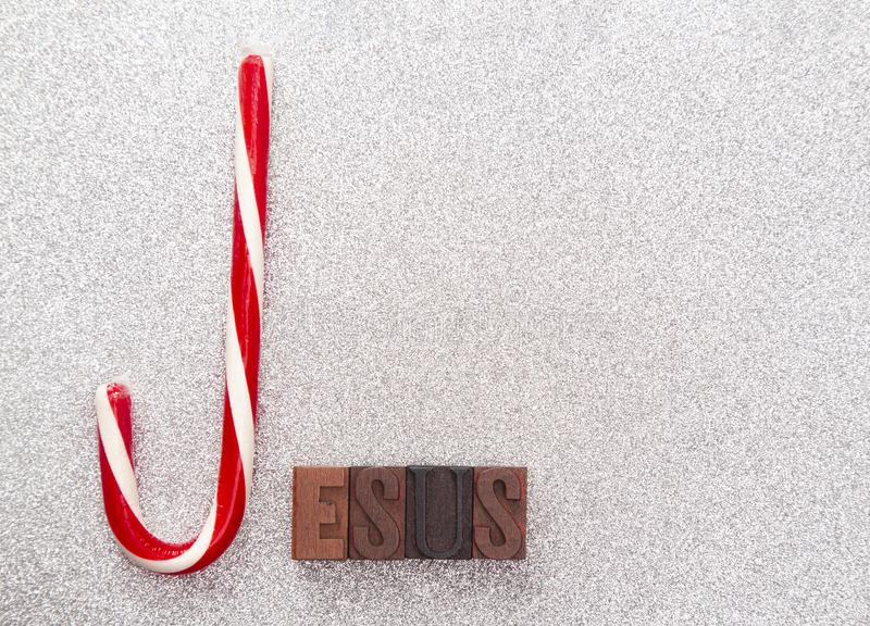 Jesus Spelled with a Candy Cane and Block Letters royalty free stock photography