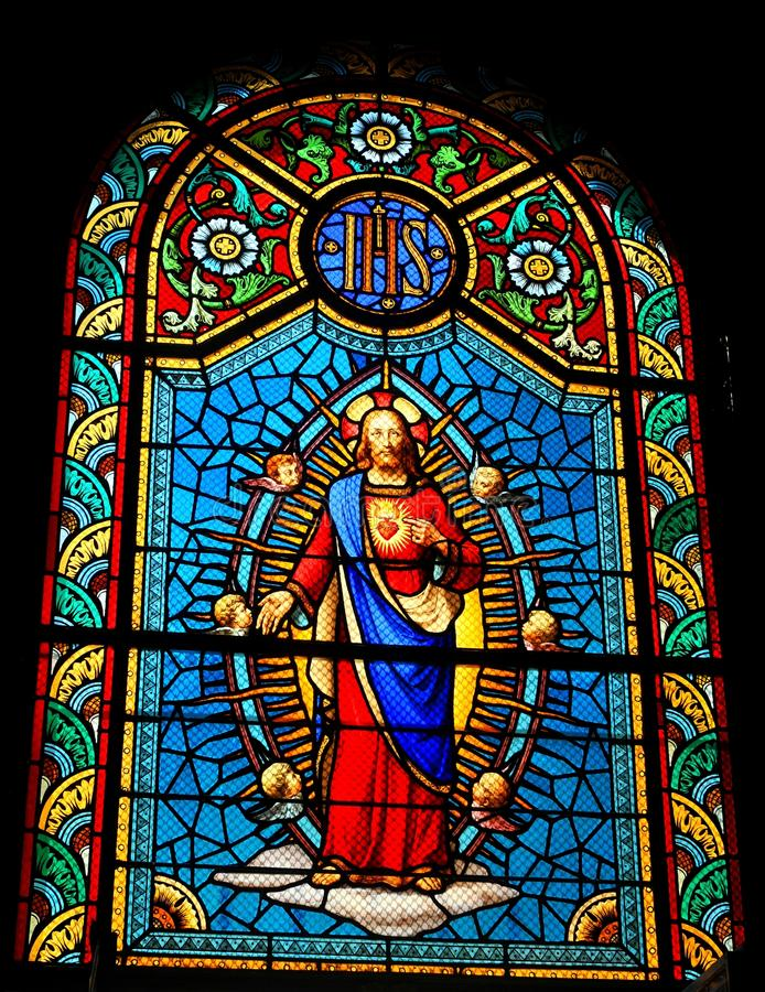Jesus. Stained glass window depicting Sacred Heart of Jesus in medieval church stock photos