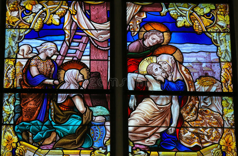 Jesus taken from the Cross - Stained Glass - Good Friday. Stained Glass window, depicting Jesus taken from the Cross into Mother Mary's arms on Good Friday, in stock photos