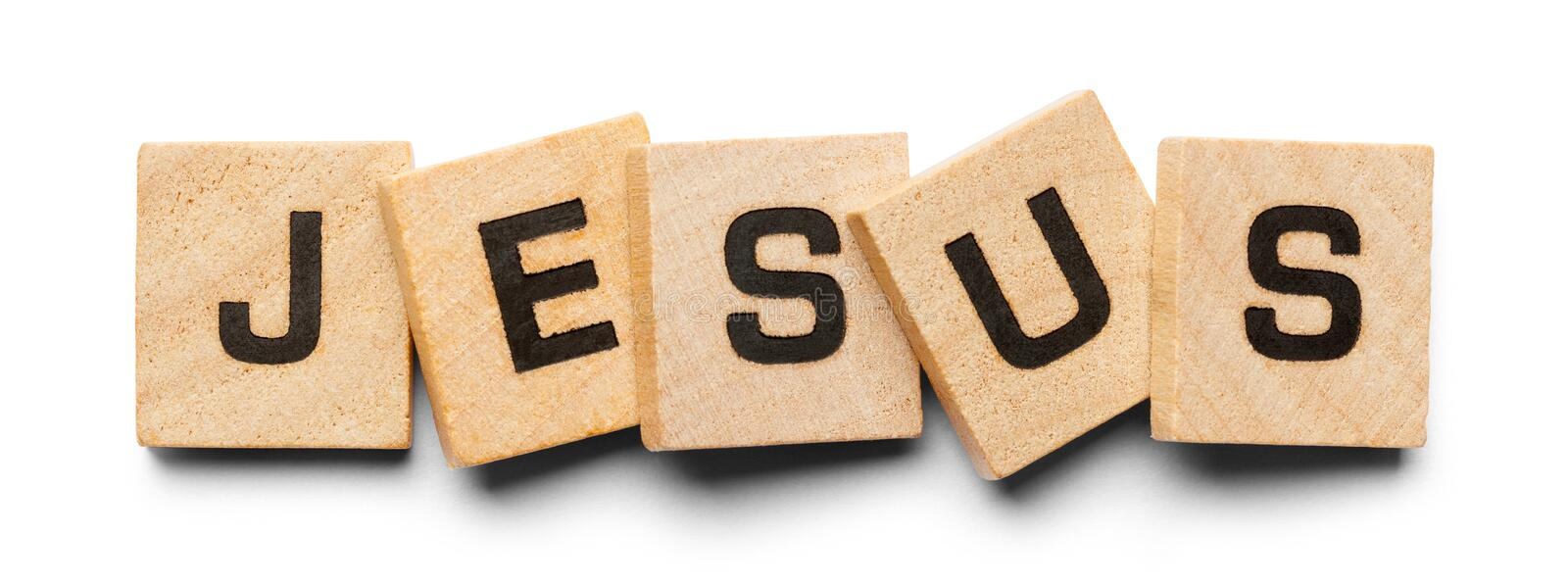 Jesus Wood Tiles. Jesus Spelled with Wood Tiles Isolated on a White Background stock photo