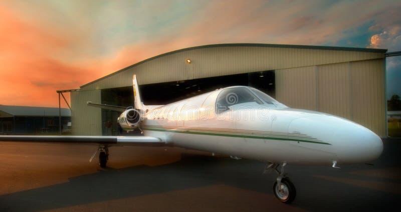 Jet Aircraft at dawn. Aircraft leaving hanger for early morning flight royalty free stock photos
