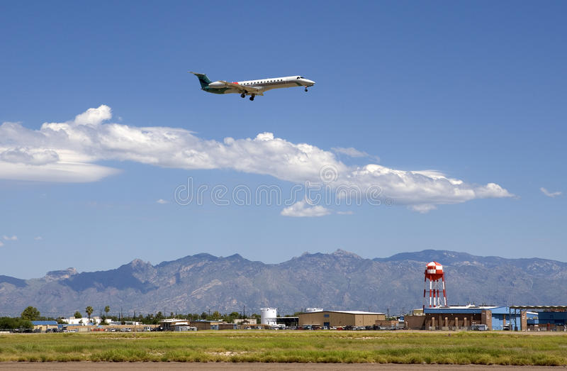 Jet landing at Tucson International Airport stock images