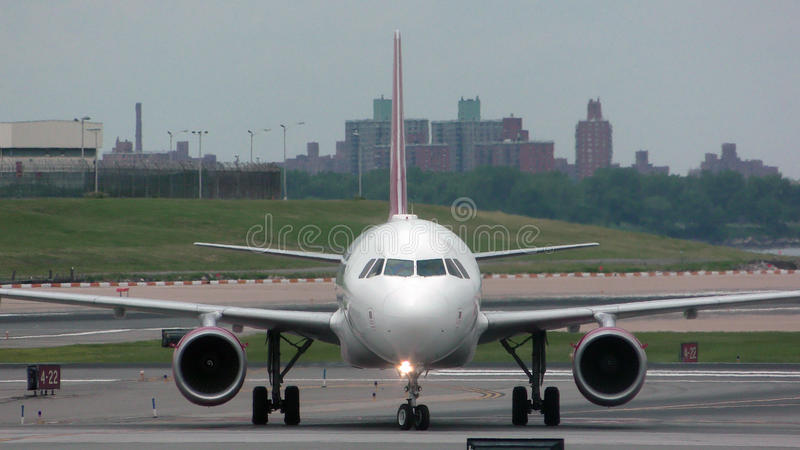 Jet airplane front view. Passenger jet airplane on a tarmac front view stock photography
