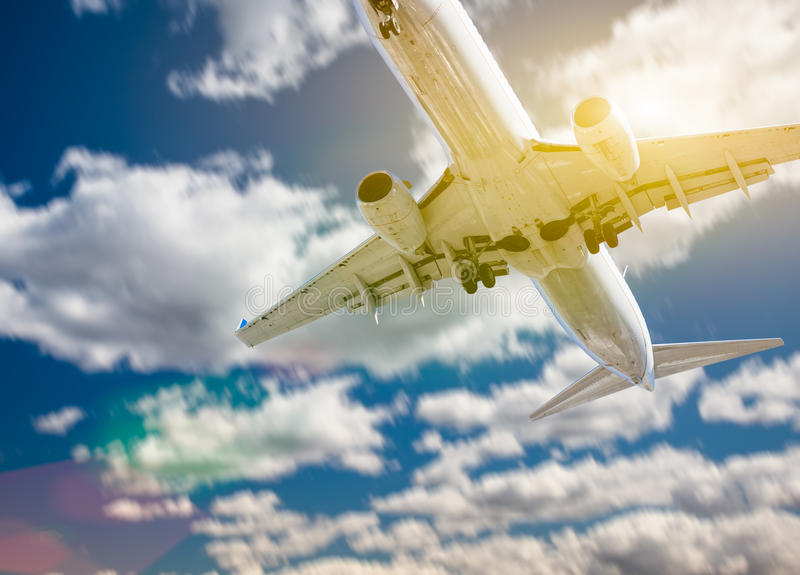Jet Airplane Landing with Dramatic Clouds Behind royalty free stock image