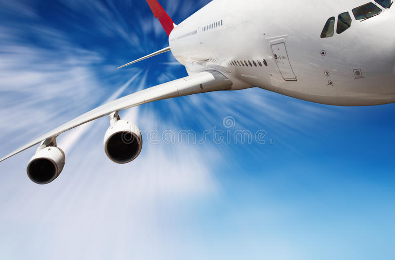 Jet airplane in the sky. With motion blur stock photos