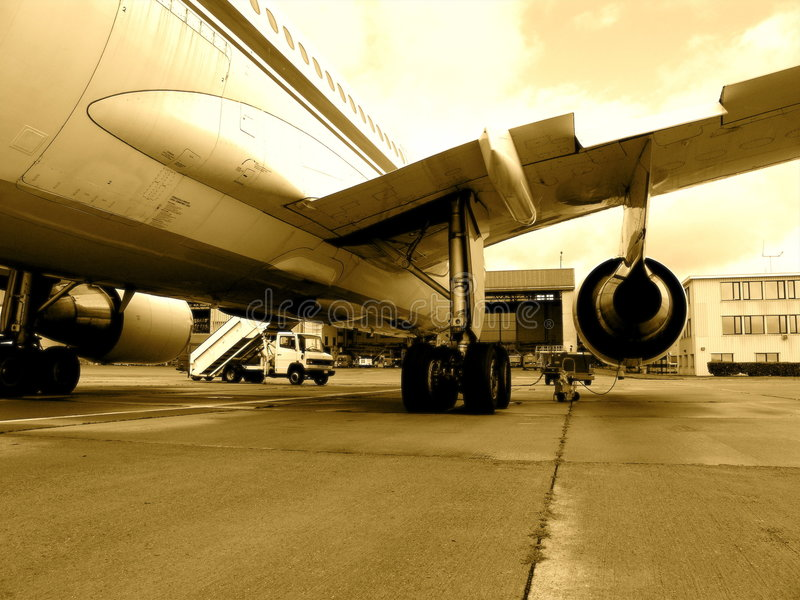 Jet airplane on tarmac. Jet airplane Belgian army on tarmac, (back view) in sepia color royalty free stock photo