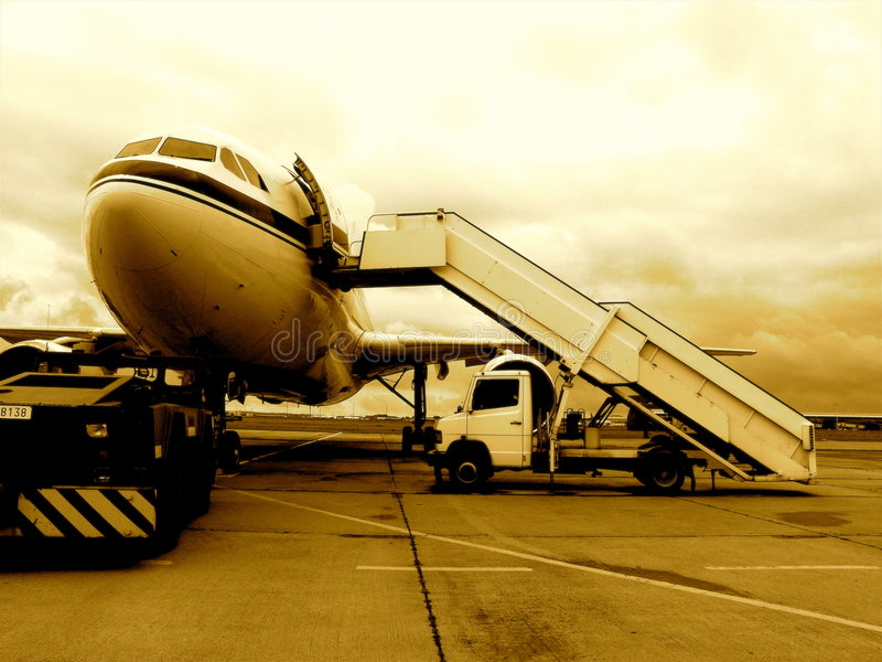 Jet airplane on tarmac. Jet airplane Belgian army on tarmac, (front view) in sepia color stock photos
