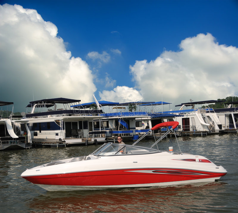 Jet Boat. Red and white jet boat in front of the marina at a lake in summer royalty free stock images
