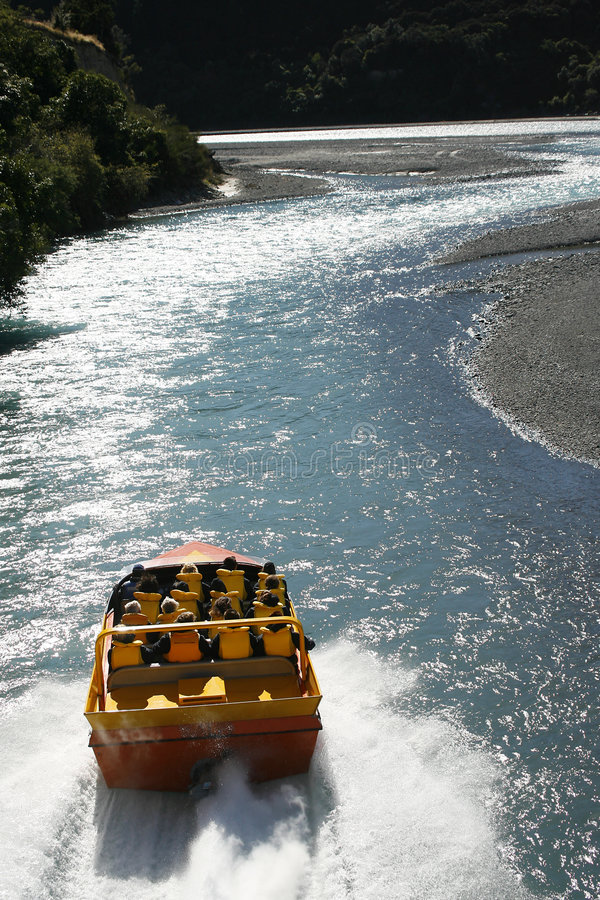 Jet Boat. A jet boat driving up the Waimakariri River in New Zealand shot from a helicopter royalty free stock images