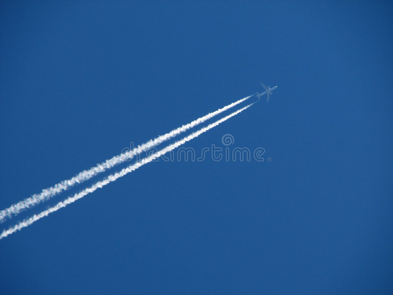 Jet and contrail royalty free stock image