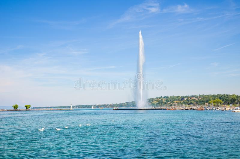 Jet d`Eau, famous water fountain in Geneva, Switzerland located on Lake Geneva. Symbol of the Swiss city. Famous landmark and stock photography