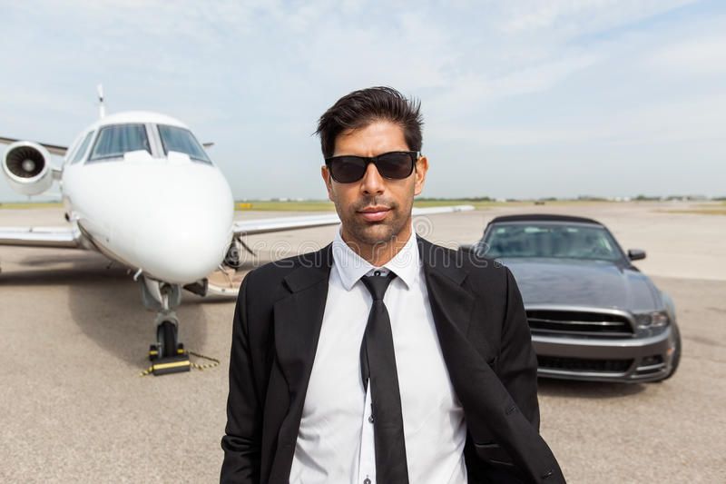 Jet de In Front Of Car And Private del empresario imagenes de archivo